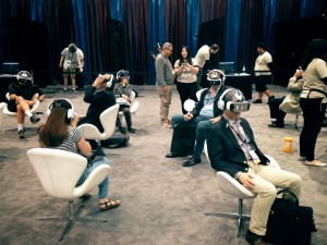 A group of people try VR headsets at NAB 2016 in Las Vegas